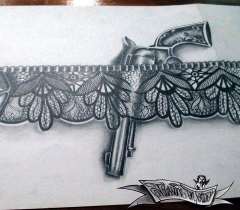 lace garter with gun tattoo design