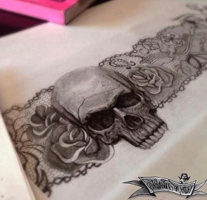 skull with sexy lace garter tattoo design