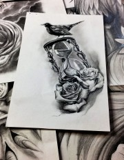 roses with hourglass tattoo design