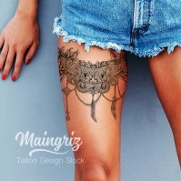 Lace garter tattoo with feather for woman created by Maingriz.com