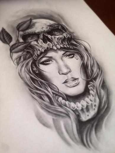 skull and face custom tattoo design